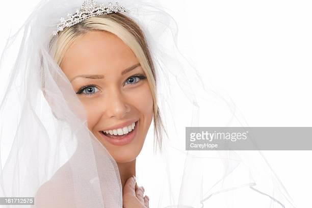 Head shot of bride in white veil