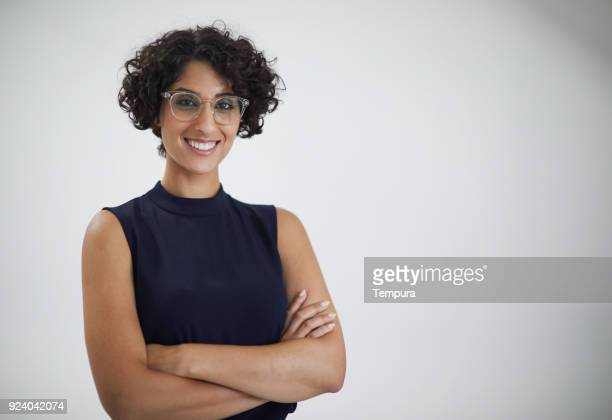 head shot of businesswoman looking at camera. - middle eastern ethnicity stock pictures, royalty-free photos & images