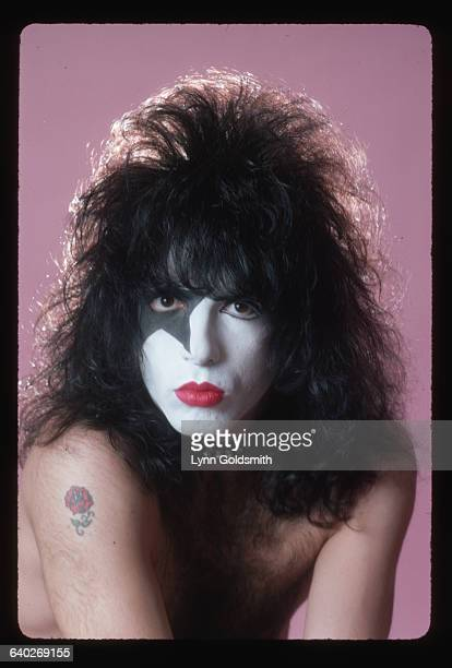 Head shot of musician Paul Stanley of the glamrock band Kiss wearing his stage makeup with his hair teased out as far as possible On his right...