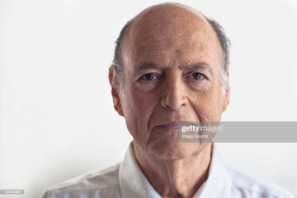 Head shot of senior man looking displeased : Stock Photo
