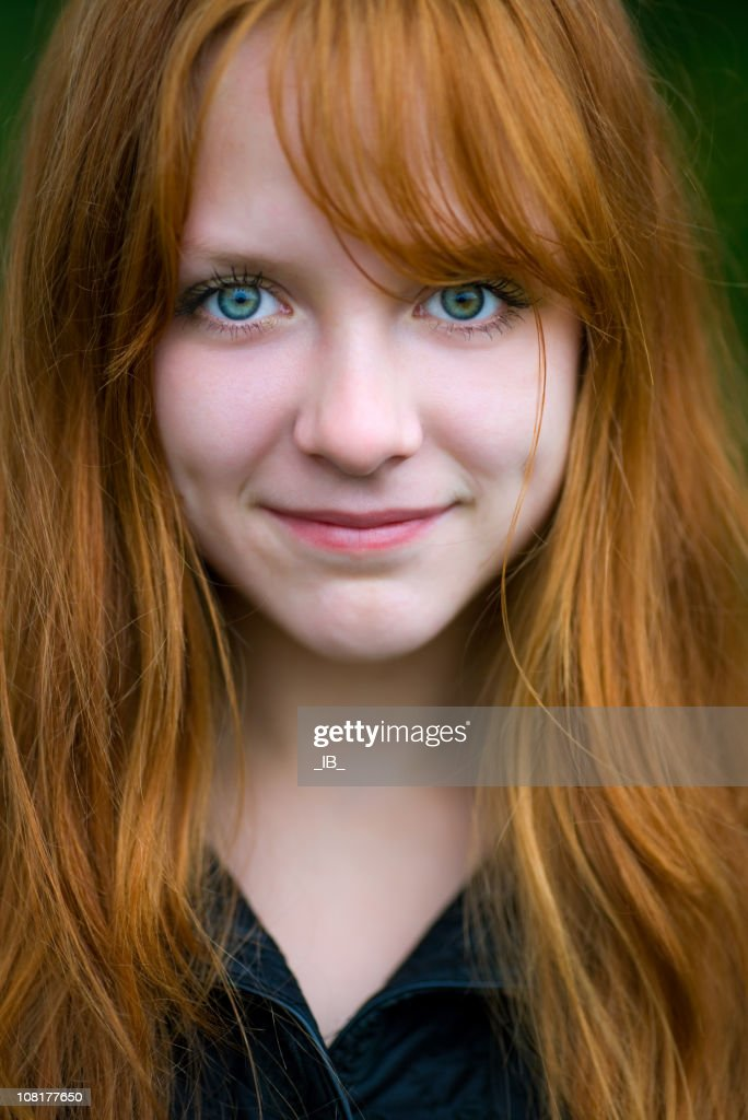 Head Shot of Young Red Headed Woman Staring Ahead : Stock Photo