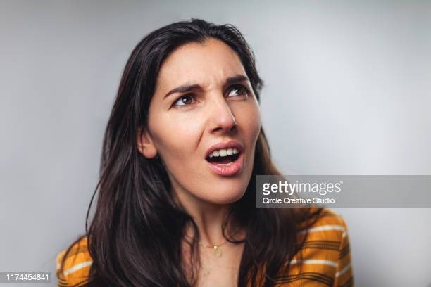 wtf! head shot portrait of shocked frustrated woman - human face stock pictures, royalty-free photos & images