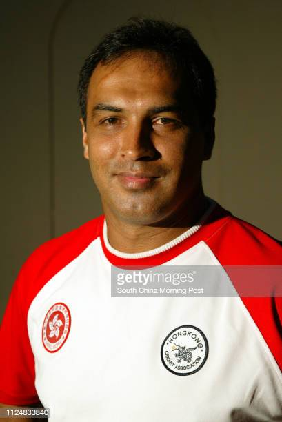 Head shots of 14 HK cricketers who will be playing in the ACC Trophy in Malaysia at Kowloon Cricket Club Hong Kong coach Robin Singh 07 JUNE 2004