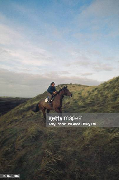 Head stable lad Barry Ellison rides Champion Thoroughbred steeplechaser racehorse 'Red Rum' 1975