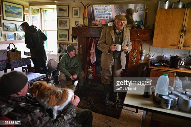 Head stalker Peter Fraser enjoys a cup of tea and a bacon butty in Callter bothy on the Invercauld Estate September 28 2012 BraemarScotland After...