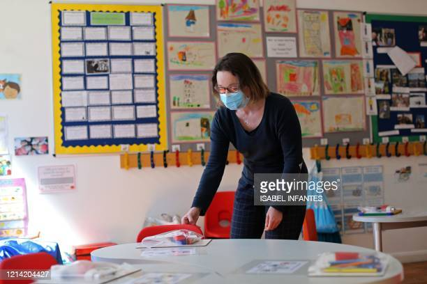 Head teacher Charlotte Beyazian rearranges materials on the tables to help provide a teaching environment safe from Coronavirus for pupils and...