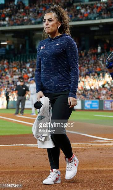 Head trainer Nikki Huffman of the Toronto Blue Jays walks off the field after checking on Vladimir Guerrero Jr #27 who was hit by a pitch at Minute...