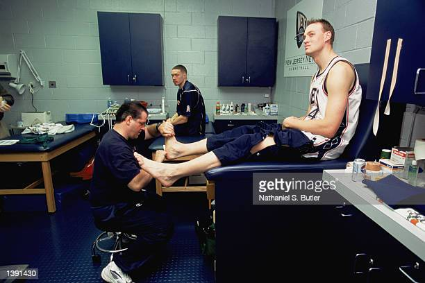 Head trainer Tim Walsh inspects the foot of forward Keith Van Horn of the New Jersey Nets before Game Four of the 2002 NBA Finals against the Los...