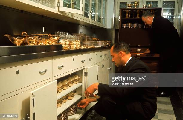 Head White House butler John Ficklin and assistant, Eugene Allen, take out the vermeil flat service prior to a state dinner for Princess Margaret and...