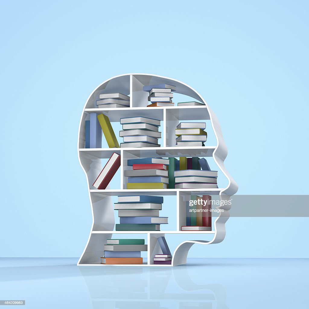 Head with a bookshelf and stacked books : Stock Photo