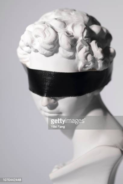 head with blindfold covering eyes - blindfold stock pictures, royalty-free photos & images