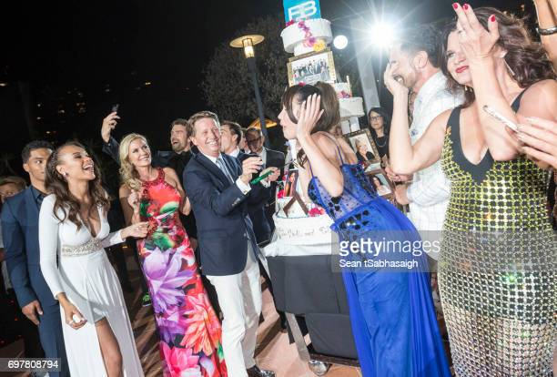 Head Writer Brad Bell cuts their anniversary cake as the actors celebrate the 'The Bold and The Beautiful' 30th Anniversary Party during the 57th...