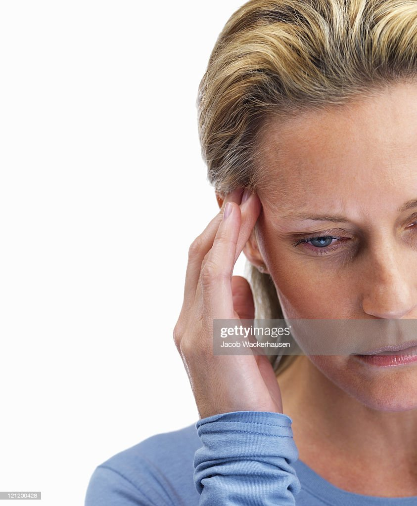 Headache -  Woman holding her head on white : Stock Photo