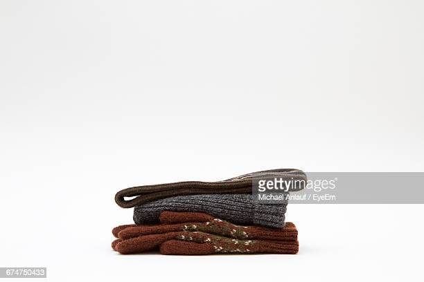 Headband With Gloves And Knit Hat Against White Background
