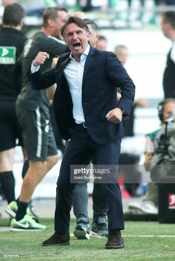Headcoach Bruno Labbadia of Wolfsburg celebrate their teams second goal scoring during the Bundesliga match between VfL Wolfsburg and 1. FC Koeln at Volkswagen Arena on May 12, 2018 in Wolfsburg, Germany.