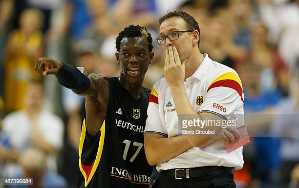 Headcoach Chris Fleming of Germany and team mate Dennis Schroeder gesture during the FIBA EuroBasket 2015 Group B basketball match between Italy and...