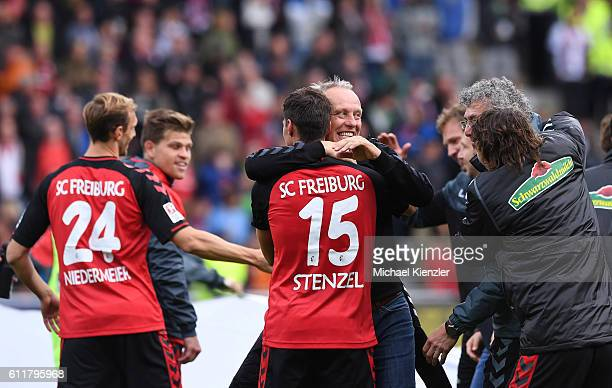 Headcoach Christian Streich and Pascal Stenzel of SC Freiburg celebrate after the Bundesliga match between Sport Club Freiburg and Eintracht...