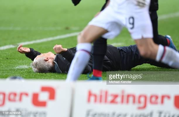 Headcoach Christian Streich of SC Freiburg lying on pitch after a check during the Bundesliga match between Sport-Club Freiburg and Eintracht...