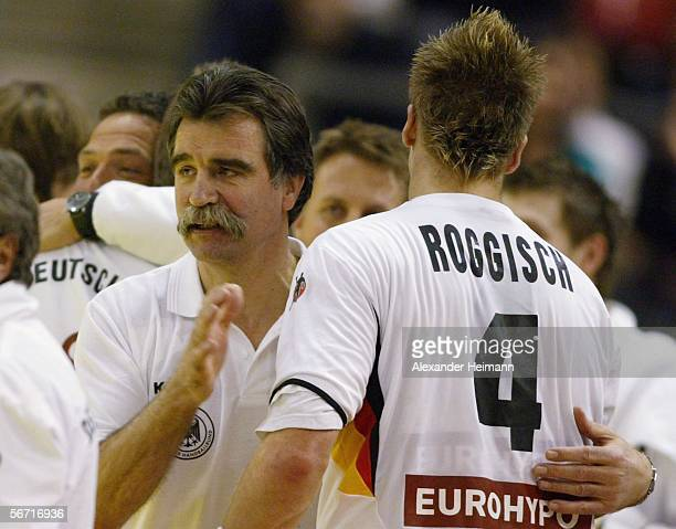 Headcoach Heiner Brand and Oliver Roggisch of Germany celebrate their victory in the Handball Euro06 main round match between Slovenia and Germany on...