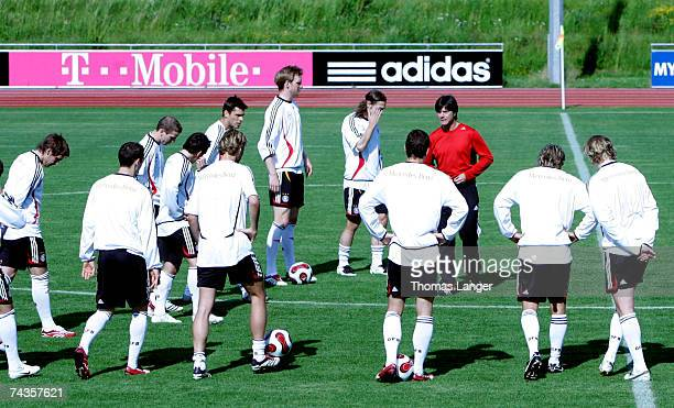 Headcoach Hoachim Loew talks to players during the German National Team training session at the AdidasStadium on May 30 2007 in Herzogenaurach Germany