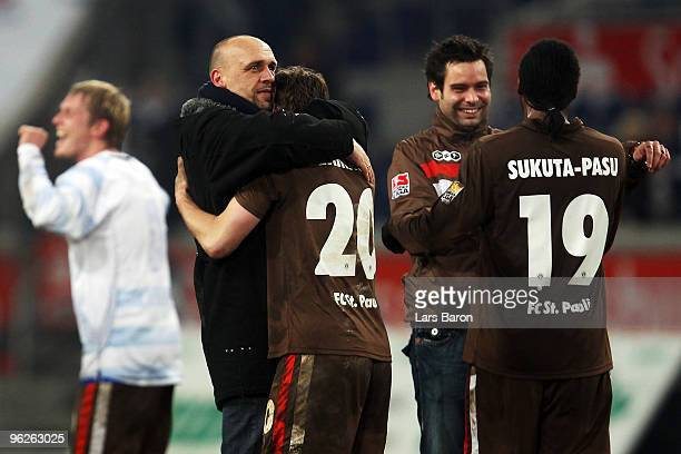 Headcoach Holger Stanislawski of St Pauli celebrates with Matthias Lehmann after winning the Second Bundesliga match between MSV Duisburg and FC St...