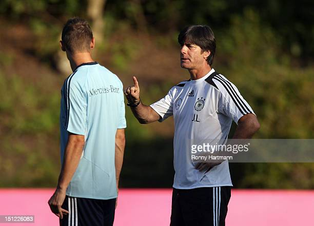 Headcoach Joachim Loew of Germany chats with Miroslav Klose during a training session on September 04, 2012 in Barsinghausen, Germany, three days...