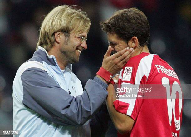 Headcoach Juergen Klopp of Mainz gives Manuel Friedrich of Mainz a friendly slap on his cheek after the UEFA Cup Qualification Round match between...