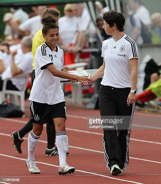 Headcoach Maren Meinert of Germany and Manjou Wilde shake hands beside the pitch during the Women's friendly match between U19 Germany and U21...