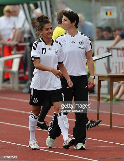 Headcoach Maren Meinert of Germany and Manjou Wilde smile beside the pitch during the Women's friendly match between U19 Germany and U21 Belgium on...