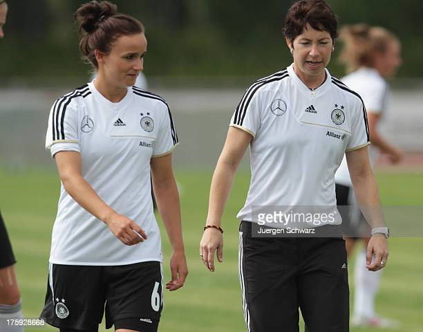 Headcoach Maren Meinert of Germany talks to Lina Magull during the Women's friendly match between U19 Germany and U21 Belgium on August 10 2013 in...