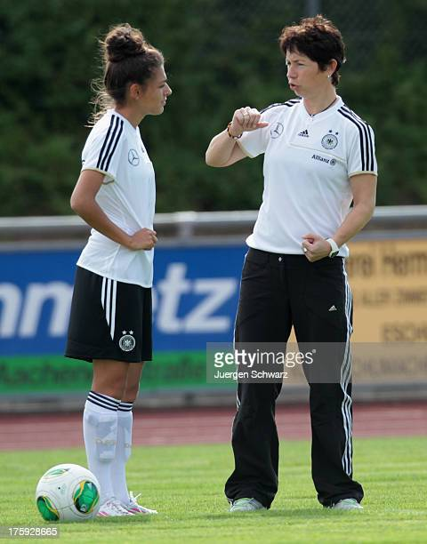 Headcoach Maren Meinert of Germany talks to Manjou Wilde prior to the Women's friendly match between U19 Germany and U21 Belgium on August 10 2013 in...
