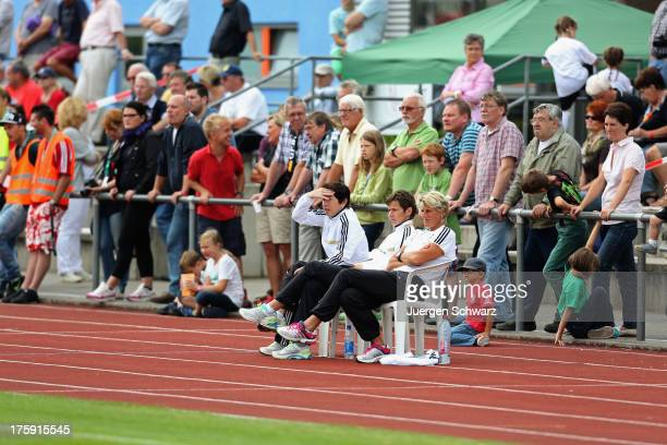 Headcoach Maren Meinert sits with Bettina Wiegmann and Silke Rottenberg beside the pitch during the Women's friendly match between U19 Germany and...