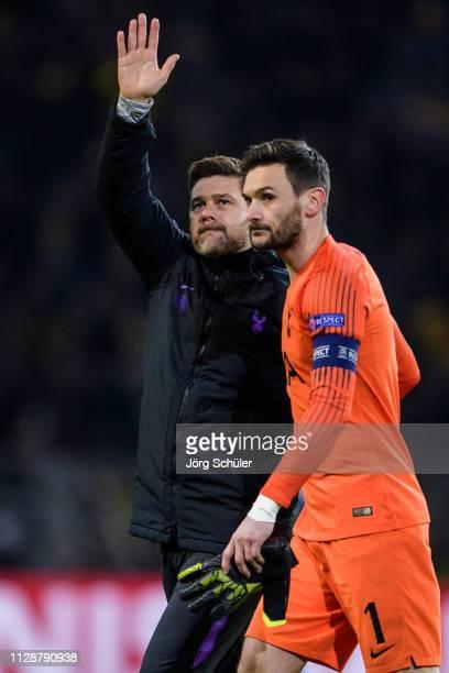 Headcoach Mauricio Pochettino and Hugo Lloris of Tottenham react after the UEFA Champions League Round of 16 Second Leg match between Borussia...