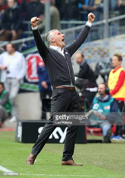 Headcoach Mirko Slomka of Hannover celebrates after the bundesliga match between Hannover 96 and FC Augsburg at HDI Arena on September 21 2013 in...