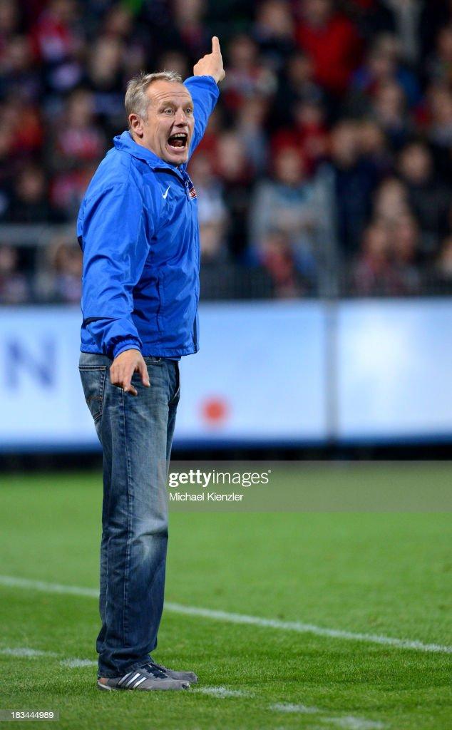 Headcoach of Freiburg Christian Streich reacts during the Bundesliga match between SC Freiburg and Eintracht Frankfurt at Mage Solar Stadium on October 6, 2013 in Freiburg, Germany.