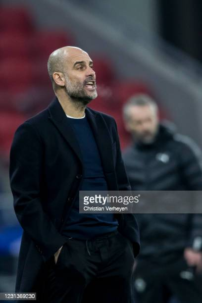 Headcoach Pep Guardiola pf Manchester City in action during the UEFA Champions League Round Of 16 Leg One match between Borussia Moenchengladbach and...