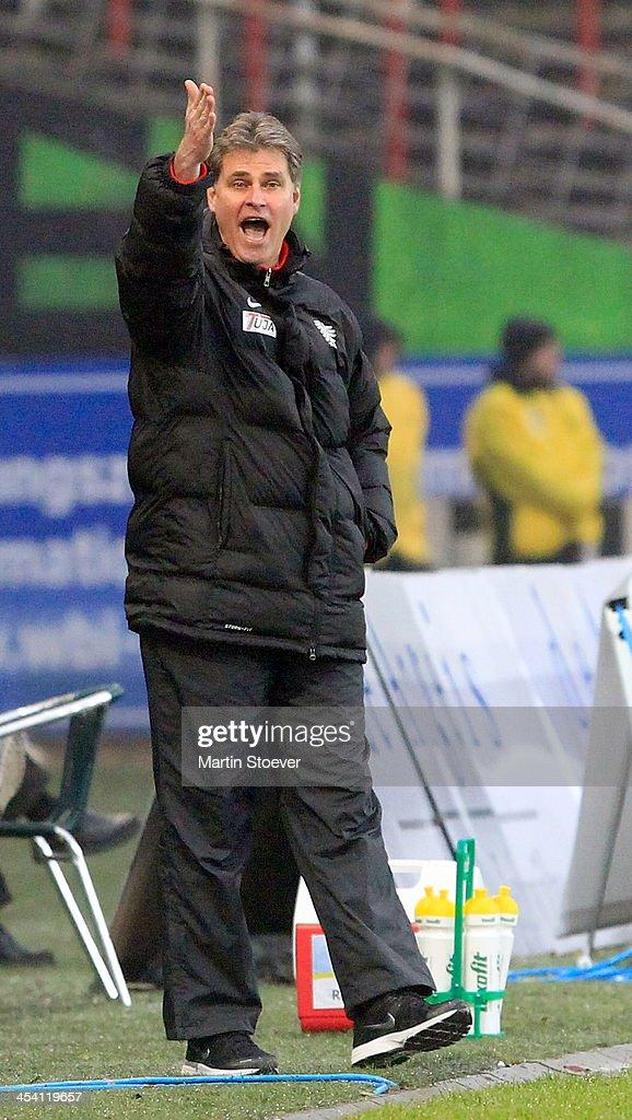 Headcoach Ralf Loose of Muenster reacts during the Third League match between Preussen Muenster and MSV Duisburg at Preussenstadion on December 7, 2013 in Muenster, Germany.
