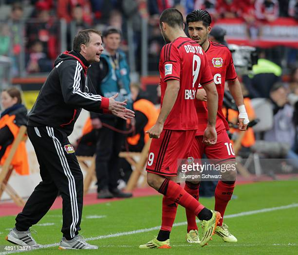 Headcoach Sascha Lewandowski of Leverkusen gives instructions to Emre Can and Eren Derdiyok during the Bundesliga match between Bayer 04 Leverkusen...