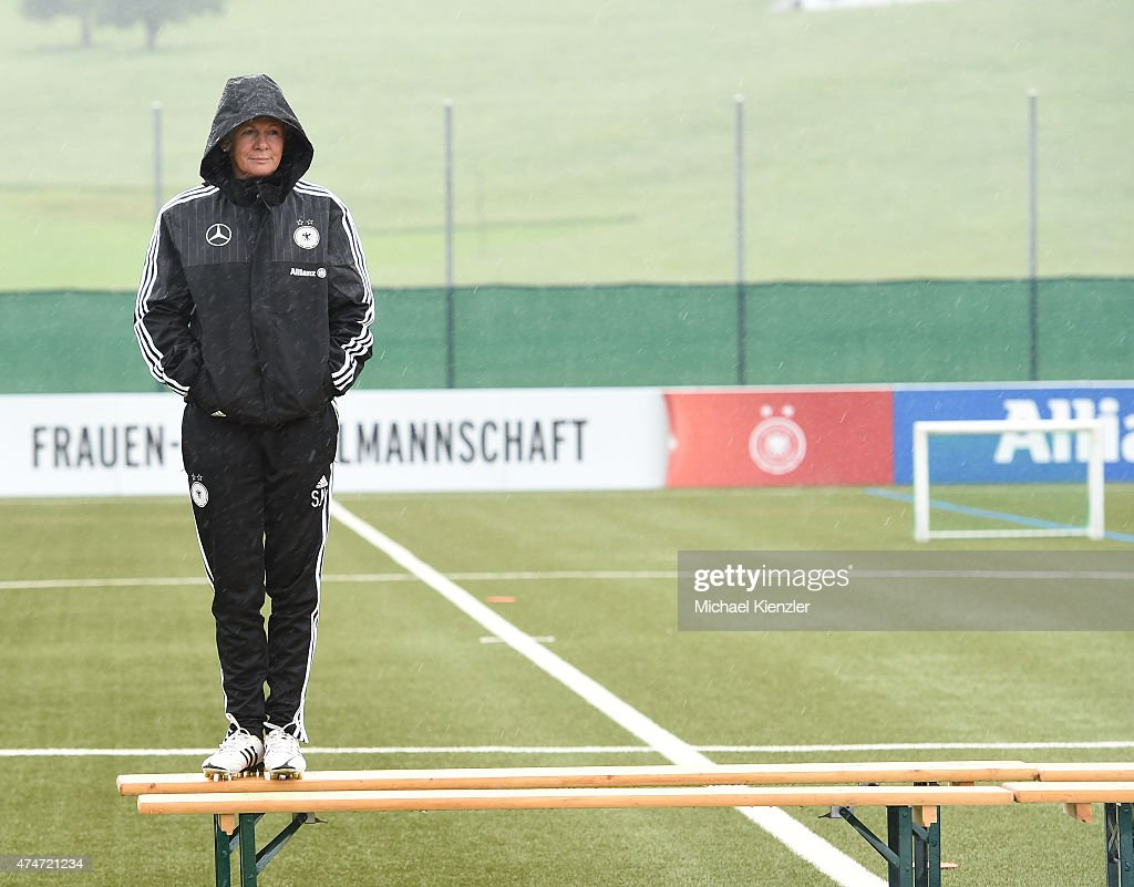 Headcoach Silvia Neid waits for a team photo to be taken during the German National Women's team training on May 25, 2015 in Wollerau, Switzerland.