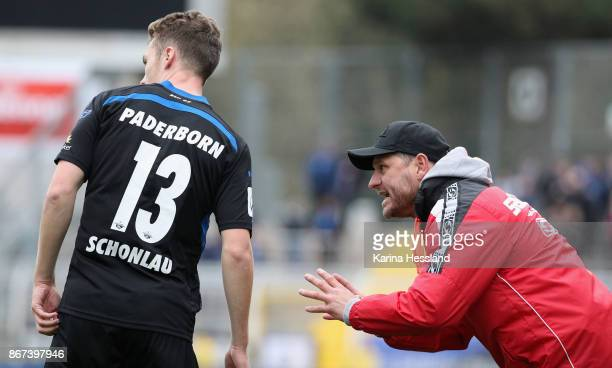 Headcoach Steffen Baumgart talks to Sebastian Schonlau of Paderborn during the 3Liga match between FC Carl Zeiss Jena and SC Paderborn 07 at Ernst...
