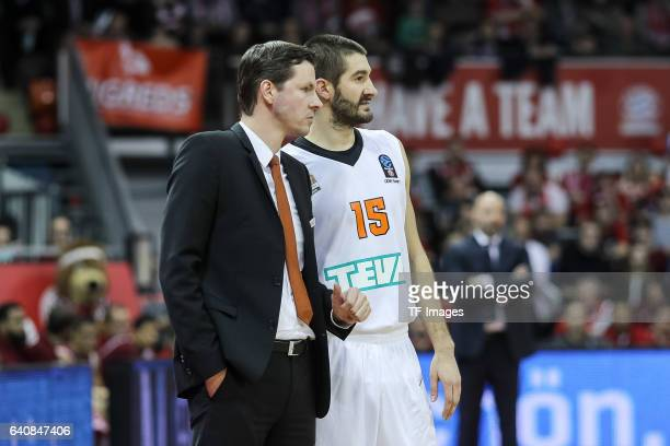 Headcoach Thorsten Leibenath of ratiopharm speak with Ulm Braydon Hobbs of ratiopharm Ulm during the Eurocup Top 16 Round 5 match between FC Bayern...