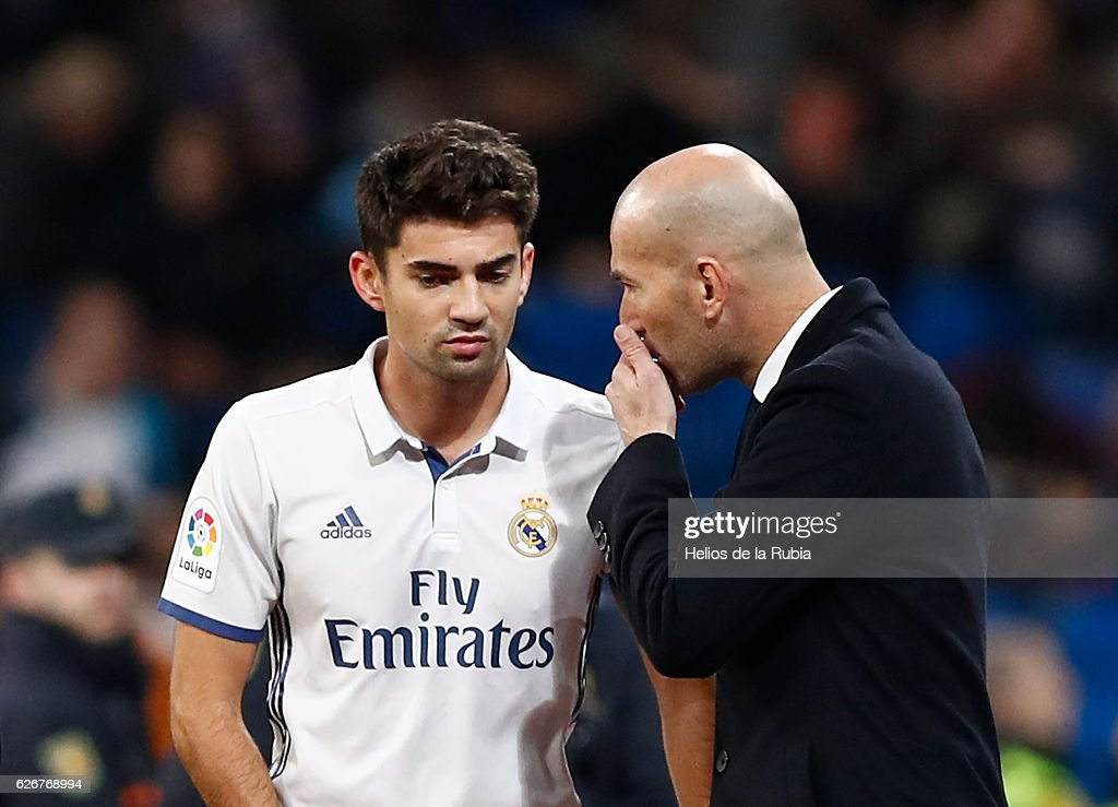 Headcoach Zinedine ZIdane speak with Enzo Zidane of Real Madrid looks on during the Copa del Rey round of 32 second leg match between Real Madrid CF and Cultural y Deportiva Leonesa at Estadio Santiago Bernabeu on November 30, 2016 in Madrid, Spain.