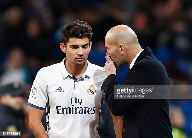 Headcoach Zinedine ZIdane speak with Enzo Zidane of Real Madrid looks on during the Copa del Rey round of 32 second leg match between Real Madrid CF...