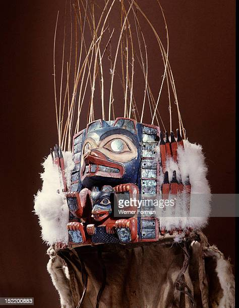Headdress worn only at important occasions  It represents a large beaver with a smaller beaver between its forelegs identified by the prominent...