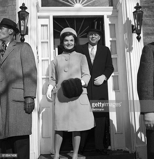 Headed For the White House. Washington, D.C.: John F. Kennedy, wearing top hat, and his wife, Jacqueline, leave their Georgetown home for the White...