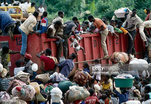 Headed to the backcountry in large trucks refugees flee from the city of Paynesville as forces from the National Patriotic Front of Liberia advance...