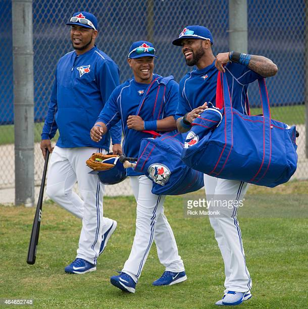 DUNEDIN FEBRUARY 27 Headed to the warm up area is from right Jose Reyes Ramon Santiago and Edwin Encarnacion The Jays work out at the Bobby Mattock...