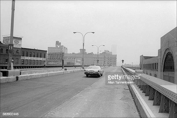 Headed towards the World Trade Center an NYPD patrol car approaches barrier on the disused West Side Highway New York New York May 15 1974 The...