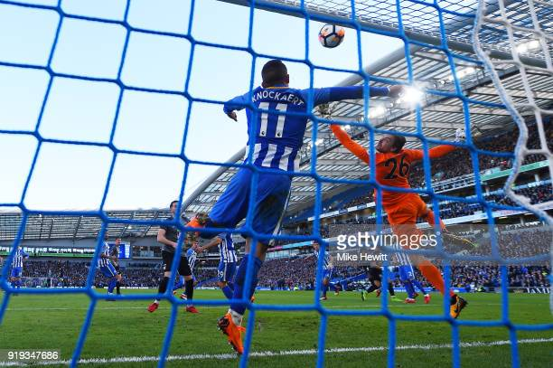 A header from Jonson ClarkeHarris of Coventry City hits the bar much to the relief of Tim Krul and Anthony Knockaert of Brighton Hove Albion during...