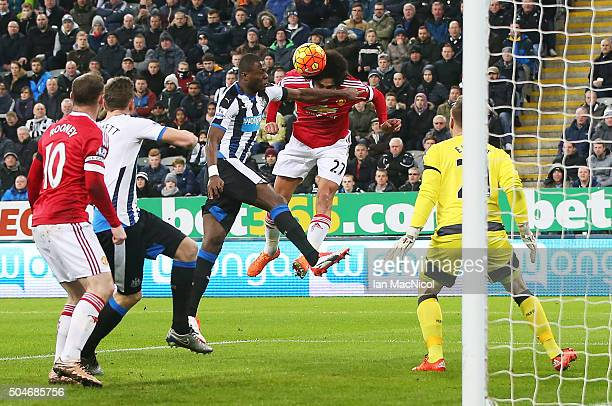 A header from Marouane Fellaini of Manchester United hits the arm of Chancel Mbemba of Newcastle United which leads to the awarding of a penalty...